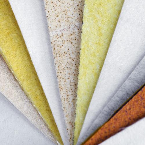 Needle felt filter fabrics